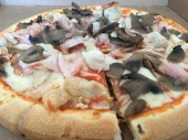 Gluten free pizza with ham and mushroom
