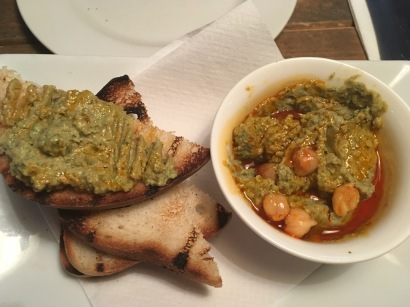 toasted cumin houmous with harissa oil